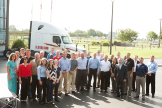 Daimler Trucks North America employees celebrate achieving the 3,000,000th vehicle milestone.