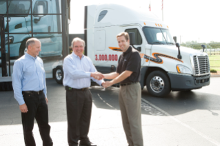 Roger Nielsen, Chief Operating Officer for Daimler Trucks North America, and Richard Shearing, Vice President of National Accounts for Daimler Trucks North America, present the keys for the 3,000,000th Daimler Trucks North America vehicle to Steve Duley, Vice President of Purchasing for Schneider.