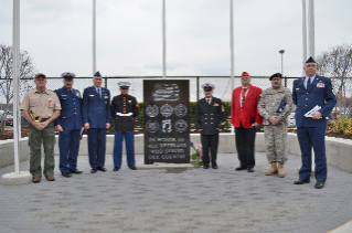 Left to right:  Bill Hardy (Bugler), Christian Tramp (Boatsman Mate Second Class, US Coast Guard), James Gray (Colonel, US Air Force Reserves), Calvin Jude Jr (Lance Corporal, US Marine Corp)  Tod Reber (Veteran's Committee Chairperson & Chief Petty Officer, US Navy Reserves), Jeff Hannack (Corporal, US Marine Corp), Al Barrera (Sargent First Class, United States Army), Tim Elliot (Master Sargent, US Air Force Reserves)