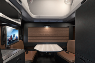 "New Cascadia 72"" Raised Roof Sleeper Cab featuring Elite Lounge Package with Driver's Loft and upper cargo shelf shown in Saddle Tan and Black"