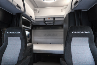 "Cascadia 72"" Raised Roof Sleeper Cab interior shown with standard lower bunk and optional upper bunk with telescoping ladder with Elite trim shown in Slate Gray and Black"